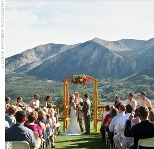 "With the majestic Whetstone Mountain behind them, the bride and groom exchanged vows beneath an arbor made by Erin's father. ""He built it with logs he cut down from our family's land in Wyoming,"" says the bride."