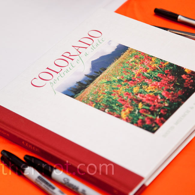 For a regionally-inspired alternative to a traditional sign-in book, the couple asked guests to sign a copy of Colorado: A Portrait of a State.