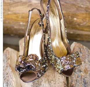 "Hillary treated herself to a pair of gold sequined Kate Spade shoes. ""I plan to wear them at many New Year's Eve parties in the future!"" she says."
