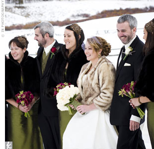 Hillarys bridesmaids kept warm with brown faux-fur jackets hand sewn by her mother. The ladies wore beautiful green dresses to complement the color scheme.