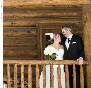 Guests gathered inside the log cabin-style Timber House at Devils Thumb Ranch for the ceremony. Massive windows provided a stunning view of the Continental Divide.