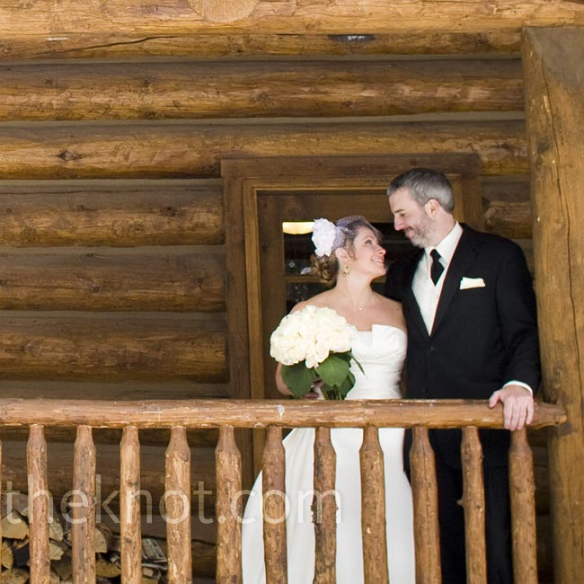 Guests gathered inside the log cabin-style Timber House at Devil's Thumb Ranch for the ceremony. Massive windows provided a stunning view of the Continental Divide.