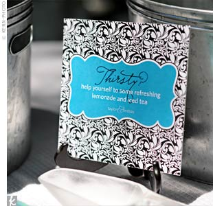Guests quenched their thirst with refreshing lemonade displayed in galvanized buckets marked with chic signs matching the rest of the wedding stationery.