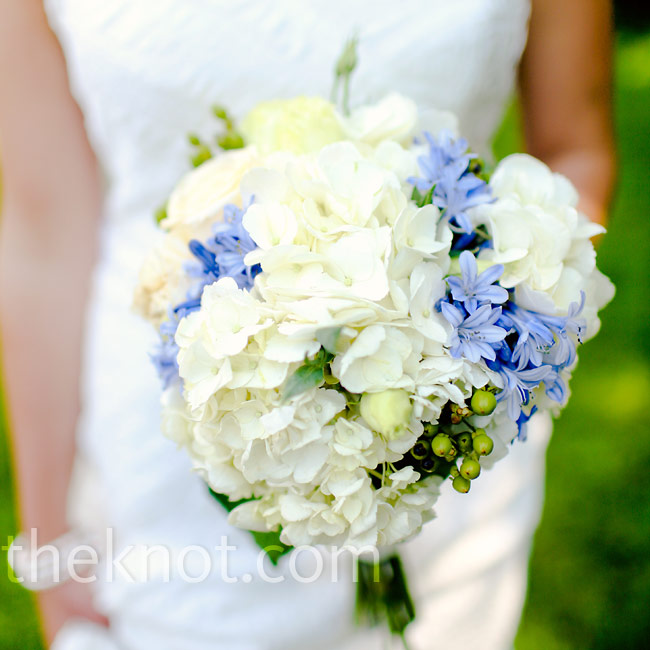 Candace carried a mostly white bouquet of stock, lisianthus, and hydrangea with galax leaves.