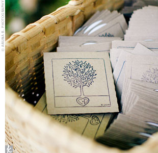 To spruce up their CD favors, Dan drew a tree growing out of a heart, which he and Candace turned into a stamp and pressed onto the recycled CD sleeves.