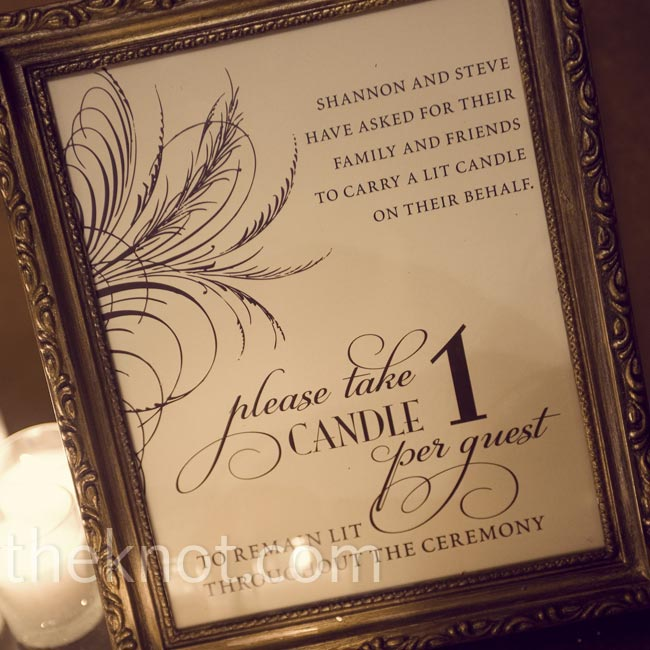 The couple created a sign asking guests to carry lit candles as a symbol of unity. Doing so set a romantic, dramatic ambience.