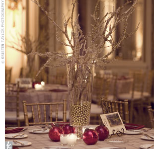 Gold pintuck linens and cranberry red napkins looked great with the Colony Club&#39;s gold chiavari chairs and ivory cushions.