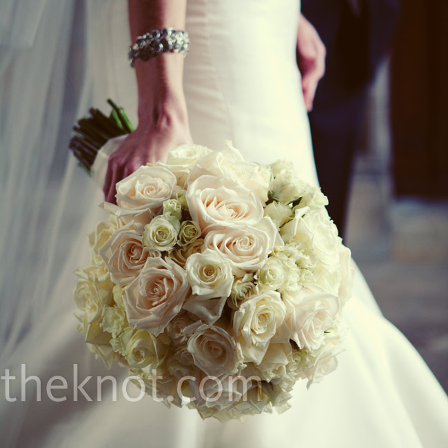 For the classic look she wanted, Alisa carried a large, round bouquet of white and ivory roses.
