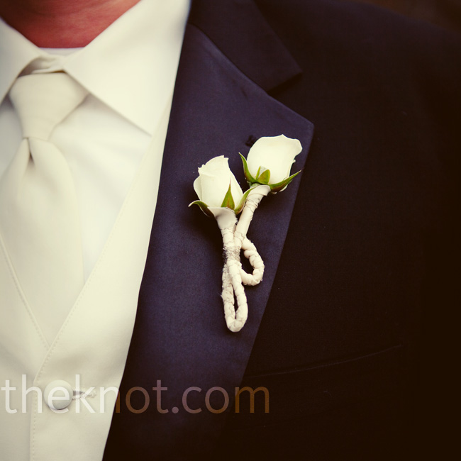 Rob wore a boutonniere of two tiny ivory roses tightly wrapped in ivory ribbon.