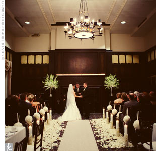 The ceremony and reception were both held in the Kuenzel Room at the Michigan Union. To distinguish the ceremony space, rose petals lined the aisle runner.