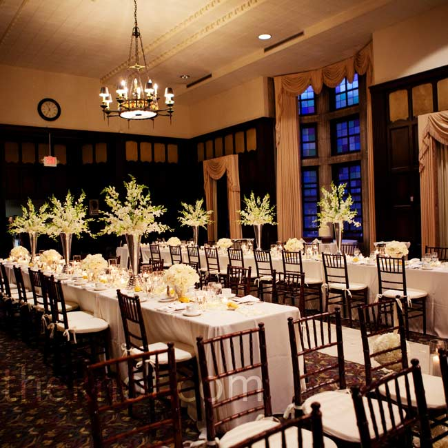 The ivory and black décor, paired with the Kuenzel Room's stained-glass windows and chandeliers, created an elegant look.