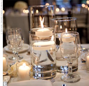 Ivory linens covered the long dining tables, which were topped with a mix of tall and short centerpieces.