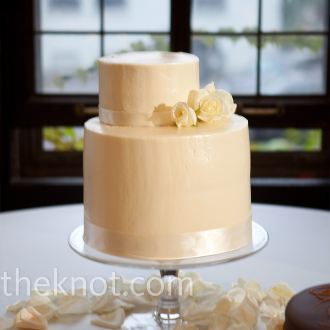 Alisa's mom made the couple's two-tiered cake with an off-center top tier, which was displayed on a simple glass pedestal from Pottery Barn for a simple yet elegant look.