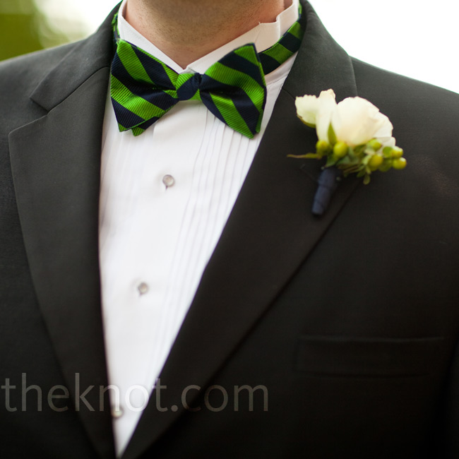 Mike wore a boutonniere of white Canadian sweetheart roses and hypericum berries.