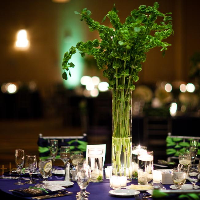 Tall centerpieces of citrus green bells of Ireland added height to the reception tables while votive candles amped up the romance.