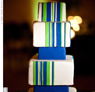 The couple&#39;s modern six-tiered cake draped in fondant mimicked their striped invites and the overall blue-and-green striped theme.