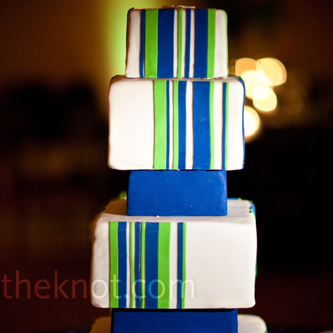 The couple's modern six-tiered cake draped in fondant mimicked their striped invites and the overall blue-and-green striped theme.