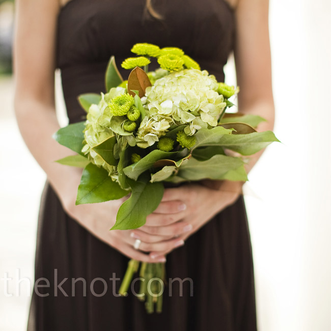The bridesmaids carried rustic bouquets of hydrangeas, leaves, and tiny mums.