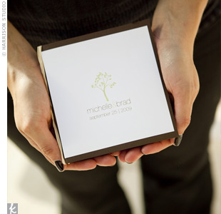 Michelle and Brad's programs were square booklets tied with raffia. They kept the cover simple, with only their tree design, names, and wedding date.