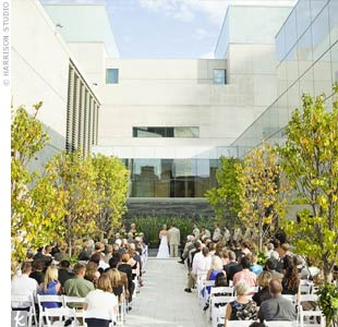 The couple exchanged vows outside the art museum. The courtyard was so pretty it didn't even need an aisle runner.