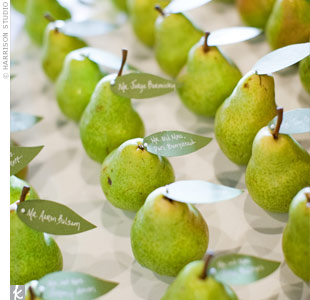 Fresh pears perfectly matched the color palette. Michelle cut green paper into leaf shapes for the guests&#39; names and tables, and then she attached them with pins.