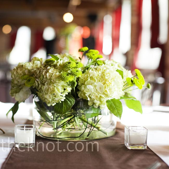 Tiny candles and low, round vases holding hydrangeas and kiwi mums decorated the tables.