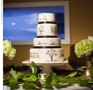 In keeping with the tree theme, the couple's fondant cake was  hand-painted with tree designs. The flavor? Pear ginger spice.