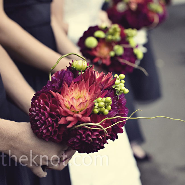 Jill wanted deep red colors to pop against the black-and-white décor, so she and her bridesmaids carried bouquets of dahlias, scabiosa pods, bupleurum, millets, berries, and curly willow.