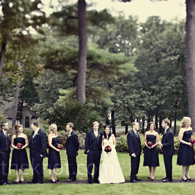 Jill stood out against her bridal party's all-black look. The girls wore chiffon dresses while the guys wore black three-piece tuxedos and plaid ties -- Nathan's idea.