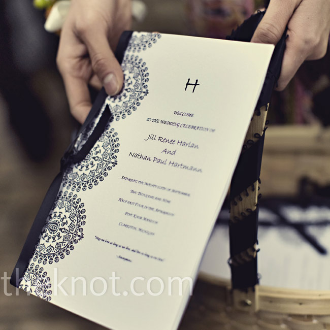 The couple made the programs and included an H at the top. They printed them on white paper with a black damask border on one side and tied them with black ribbon.