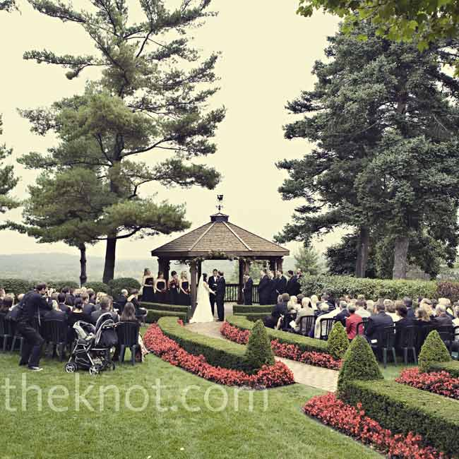 It rained the entire morning and afternoon of the wedding, but the sky cleared right before the ceremony, which took place in the mansion's manicured garden.