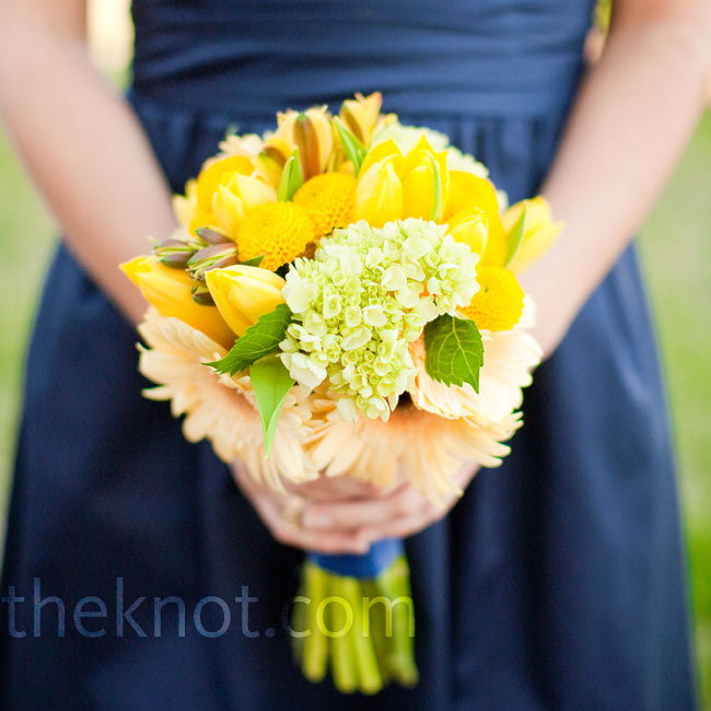 The bridesmaids carried yellow bouquets of daisies, tulips, button mums, and freesia. Green hydrangeas were added to mimic Brecklyn's bouquet.