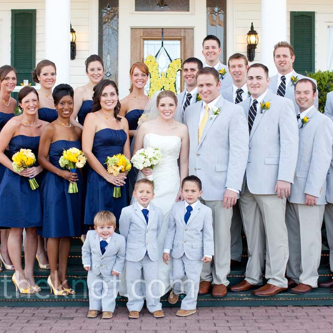 Brecklyn's bridesmaids ranged in height from 5'2 to 5'10, so she needed something that would flatter a variety of shapes. Her choice? A strapless A-line dress. The bouquets matched the girls' heels and necklaces. While the groomsmen all donned seersucker jackets, Matt's yellow-and-white-striped tie differed from his men's navy blue and yellow ties.