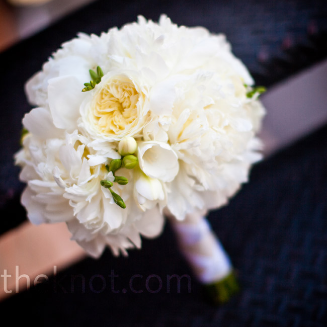 "Joy carried an all-white bouquet of peonies, Lily of the Nile, hydrangeas, ranunculus and lisianthus. ""I LOVED my bouquet!"" she says. ""It was just what I was hoping for."""