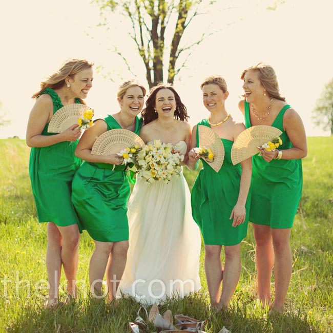 Each bridesmaid accessorized with silver, gray, yellow, or green shoes and jewelry.