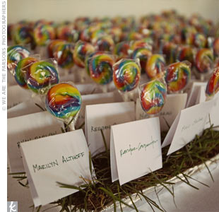 Instead of paper, Eagen and Jason used miniature rainbow lollipops as escort cards. They stuck them into grass sod planters so that they looked like they were growing out of the grass. Family members took turns writing names so that the font looked fun and casual.
