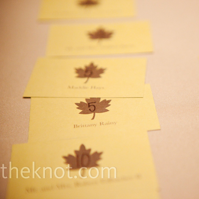 The yellow square escort cards were marked with a brown maple leaf motif, in coordination with the rest of the day's details.