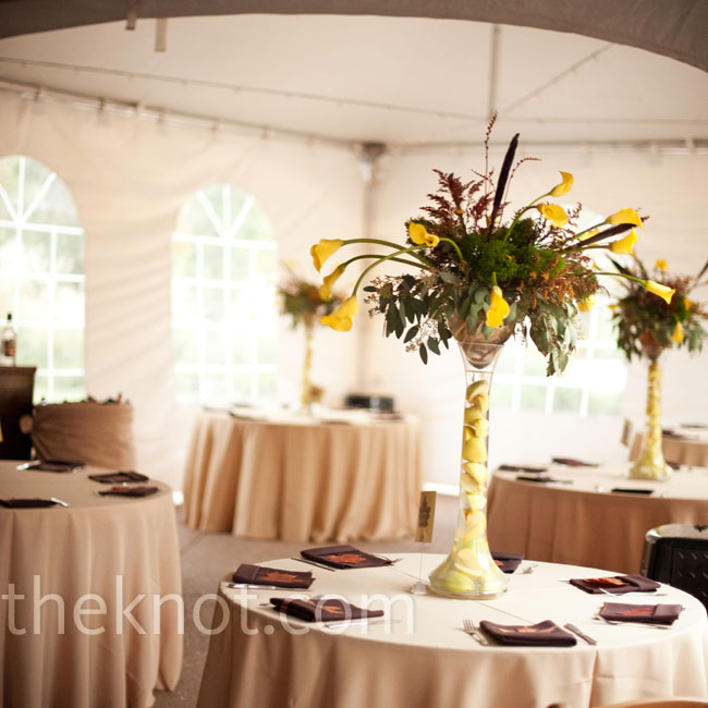 Inside the manor, reception tables were set up and covered with tan floor-length linens. Tall centerpieces accented with yellow calla lilies, wheat and greenery topped them off.