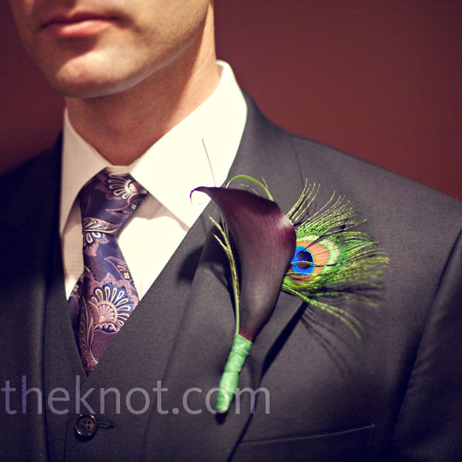 Zach's boutonniere was a unique combo: a mini eggplant calla lily, bear grass, and a peacock feather.