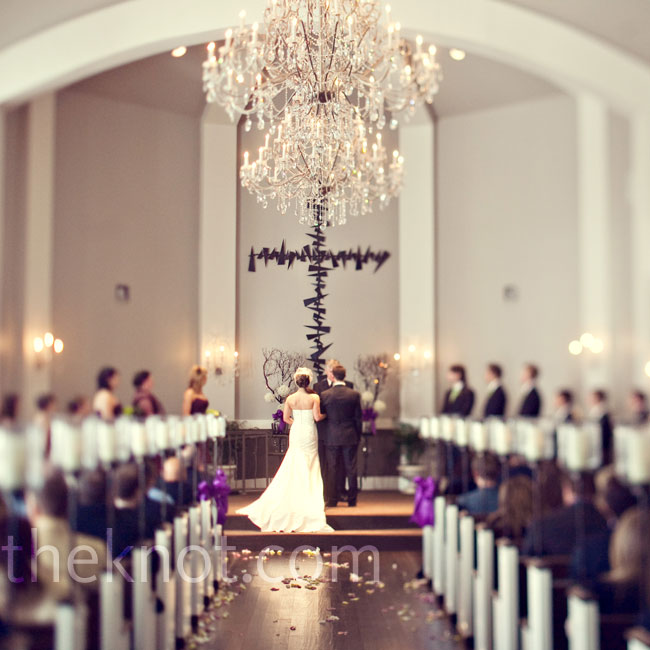 Sunlight shone through the chapel's large windows for the 9 a.m. ceremony. Hurricane lamps dotted the pews and regal chandeliers hung overhead.
