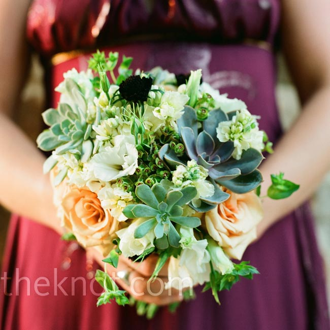 The bridesmaid dresses, a rich berry color, perfectly complemented the bouquets of cream stock, roses, white lisianthus, burgundy scabiosa, dogeye euphorbia, and green bupleurum.