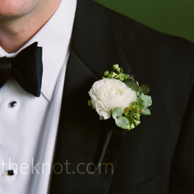 Adam's fresh mix of white ranunculus, euphorbia, and tiny succulents in his boutonniere went nicely with his dress bow tie.