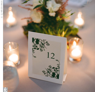 Like the escort cards, Chelle bought a DIY template for the table numbers, which the couple created out of cardstock.