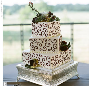 Their buttercream-frosted cake was decorated with a scrollwork design and fresh flowers. Inside, it was strawberries and cream.