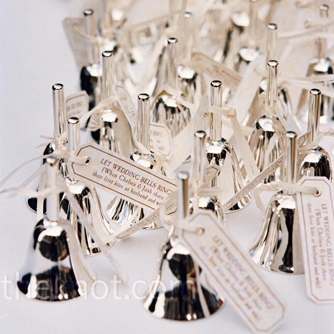 guests were given silver bells with tags that read let wedding bells
