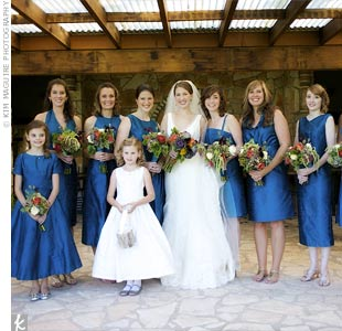 Emily gave her girls several yards of peacock blue dupioni silk and had them design their own dresses. She didn't even see most of the styles until the wedding day.