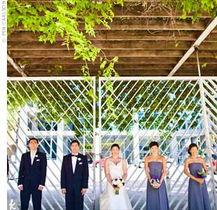 The groomsmen&#39;s silvery gray ties coordinated with the bridesmaids&#39; gray chiffon dresses.