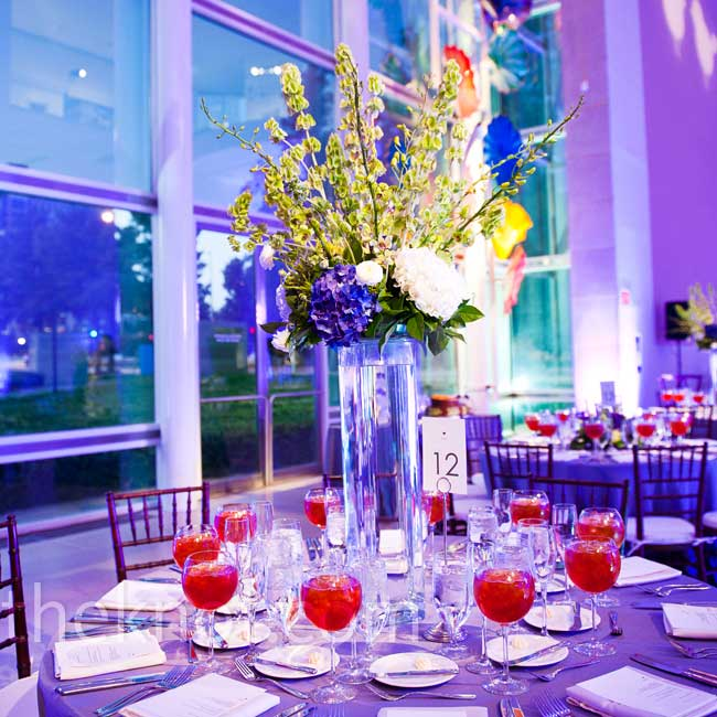 The centerpieces overflowed with dendrobium orchids, bells of Ireland, dahlias, hydrangeas, and Kermit and spider mums.