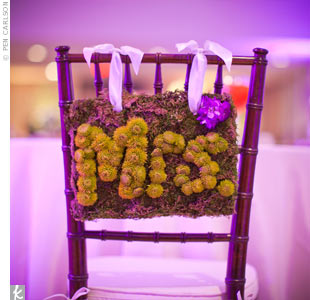 At the sweetheart table, Esther and Joes chairs were designated with signs reading Mr. and Mrs., spelled out in lime green Kermit mums.