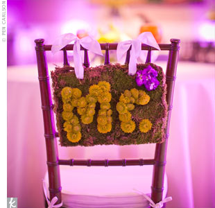 "At the sweetheart table, Esther and Joe's chairs were designated with signs reading ""Mr."" and ""Mrs.,"" spelled out in lime green Kermit mums."